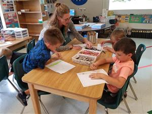 Photo of students and teacher in art class BCES
