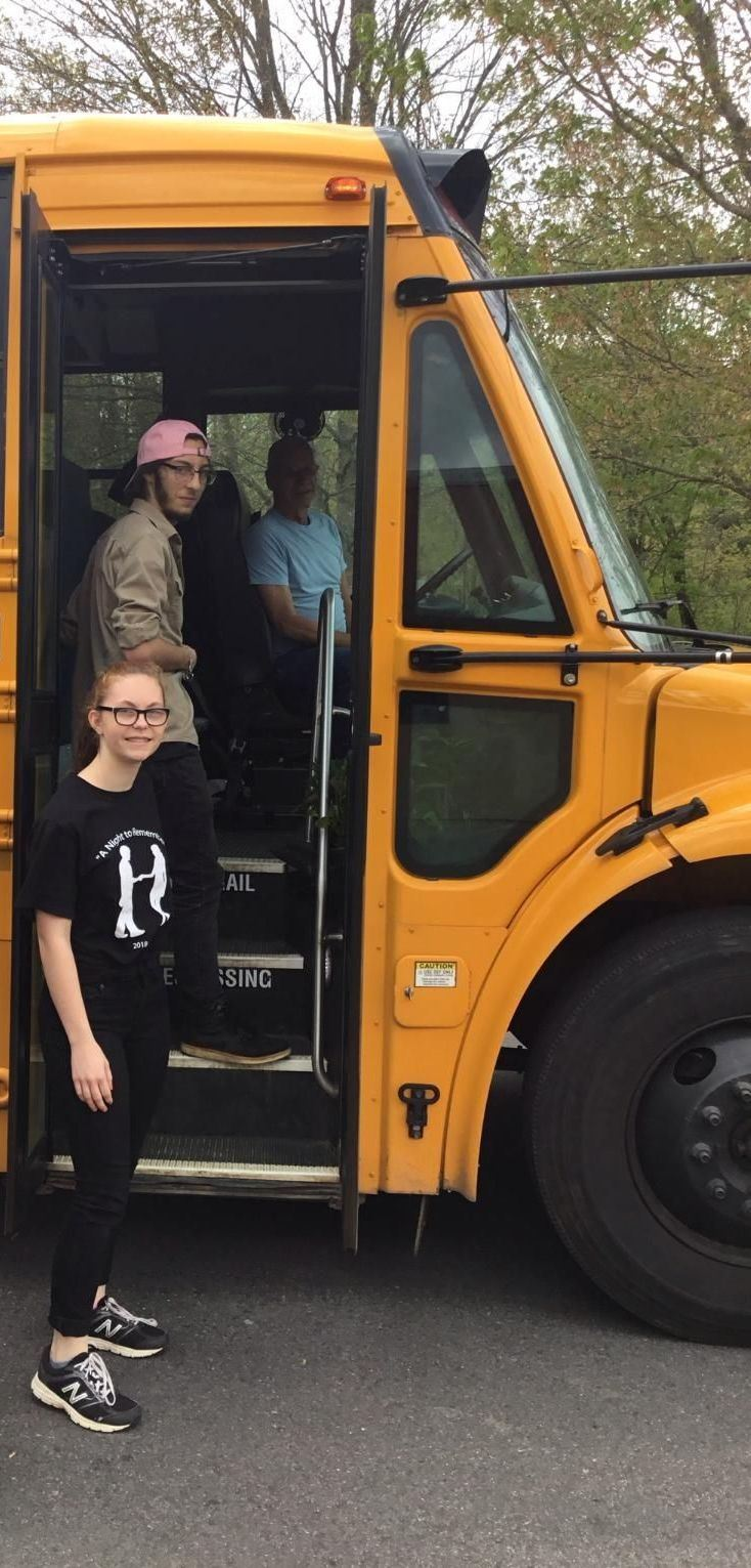 Photo of school bus with driver and students