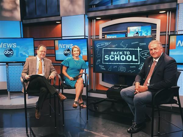 Photo of Superintendent and WLOS ABC 13 Anchors