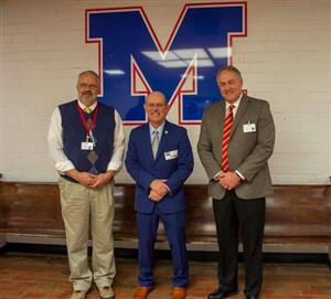 Photo of MCS Superintendent and Board Chairperson with MHU President