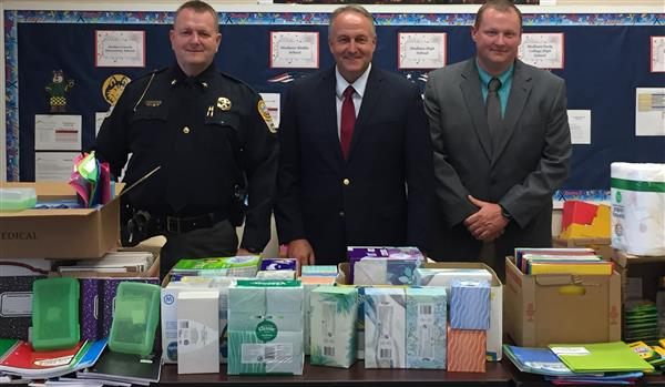 Photo of Dr. Hoffman, Sheriff Buddy Harwood, & Coy Phillips Tools for School Supplies